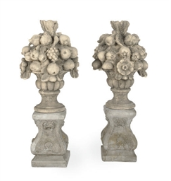 A PAIR OF COMPOSITE STONE FRUI