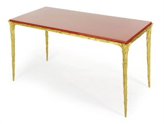A GILT-BRONZE AND RED-LACQUER
