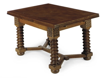 AN OAK DRAW-LEAF DINING TABLE,