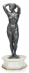 A PATINTED BRONZE FIGURE OF A