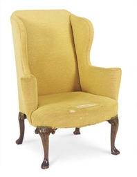 A GEORGE I WALNUT WINGBACK ARM