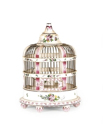 A CONTINENTAL FAIENCE BIRDCAGE