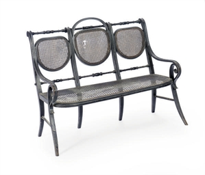 AN EBONIZED THREE-CHAIR BACK C