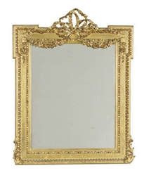 A FRENCH GILTWOOD AND GILT-COM