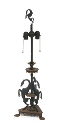 AN EBONIZED CAST-IRON LAMP,