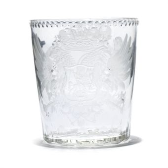 AN ENGRAVED AND POLISHED GLASS BEAKER