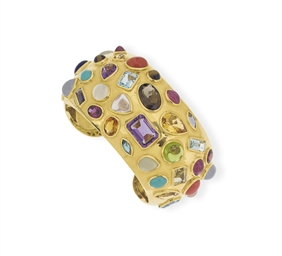 **A MULTI-GEM AND GOLD BRACELE