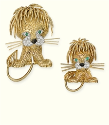 A PAIR OF GEM SET LION BROOCHE