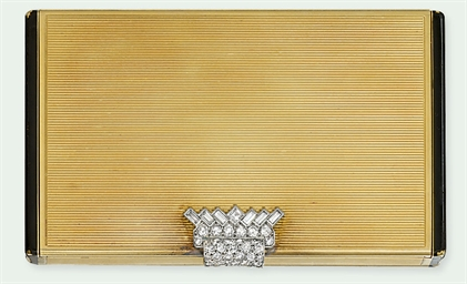 AN ART DECO GOLD, DIAMOND AND