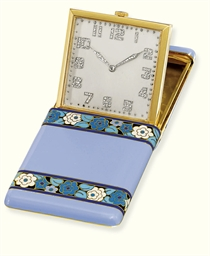 AN ENAMEL AND DIAMOND TRAVEL C