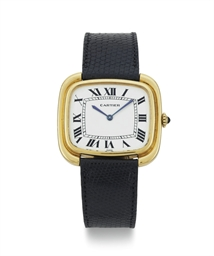 CARTIER.  AN 18K GOLD WRISTWAT