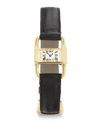 CARTIER.  A RARE 18K GOLD BACK