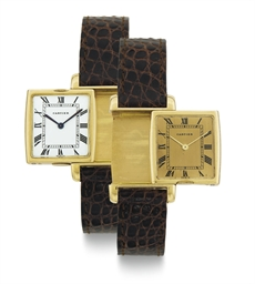 CARTIER. AN 18K GOLD REVERSIBL
