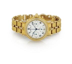 BREGUET.  AN 18K GOLD, DIAMOND