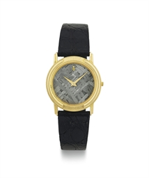 CORUM.  AN 18K GOLD AND METEOR