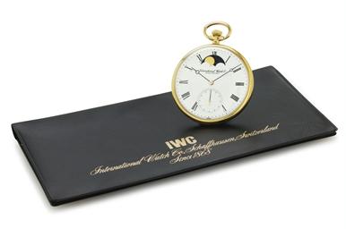IWC. AN 18K GOLD OPENFACE KEYL