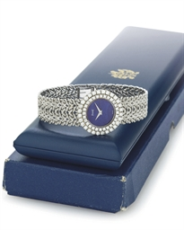 PIAGET A LADY'S 18K WHITE GOLD, DIAMOND AND LAPIS LAZULI WR...