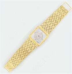A diamond set wristwatch, by B