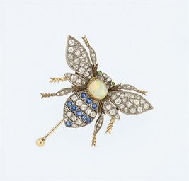 A diamond and gem brooch