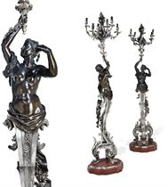A PAIR OF LARGE FRENCH SILVERED AND PATINATED BRONZE FIGURAL SIX-LIGHT TORCHERE-CANDELABRA