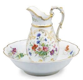 A GERMAN PORCELAIN FLOWER-ENCR