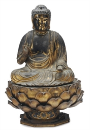 A JAPANESE GILT-WOOD BUDDHA ON