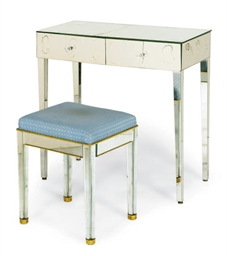 A MIRRORED DRESSING TABLE AND