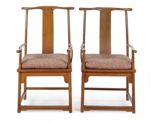 A PAIR OF HARDWOOD ARMCHAIRS,