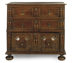 AN ENGLISH OAK CHEST-OF-DRAWER