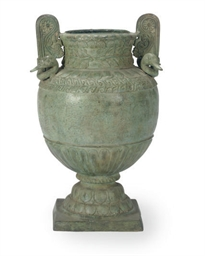 A GREEN-PATINATED BRONZE URN,