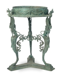 A GREEN-PATINATED BRONZE SIDE