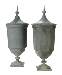 A PAIR OF ZINC GARDEN URNS WIT