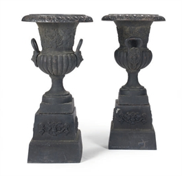 A PAIR OF BLACK-PAINTED CAST I