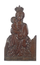A CARVED WOOD PANEL OF MADONNA