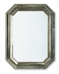 A BEVELED GLASS MIRROR,