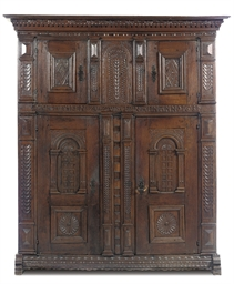 A GERMAN OAK CUPBOARD