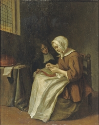 A young woman doing needlework
