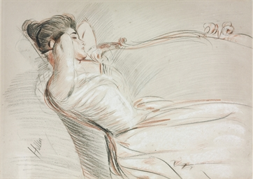 A woman reclining on a sofa