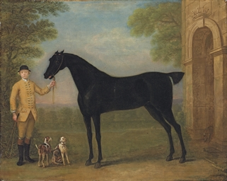 A dark bay racehorse held by a