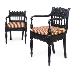 TWO CEYLONESE EBONY ARMCHAIRS