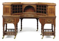 A VICTORIAN WALNUT LIBRARY DESK