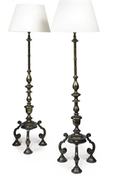 A PAIR OF SILVERED-STANDING LA