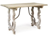 AN ARTS AND CRAFTS 'TUSCAN-STYLE' LIMED-OAK TABLE