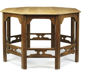 AN OAK OCTAGONAL CENTRE TABLE