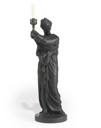 A REGENCY EBONISED PLASTER FIG