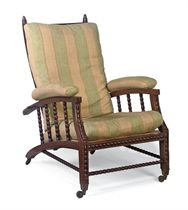 AN ARTS AND CRAFTS MAHOGANY RECLINING ARMCHAIR