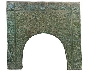 A TURQUOISE-GLAZED CARVED STON