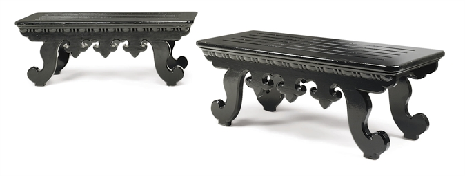 A PAIR OF EBONISED BENCHES