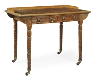 A VICTORIAN OAK WRITING TABLE