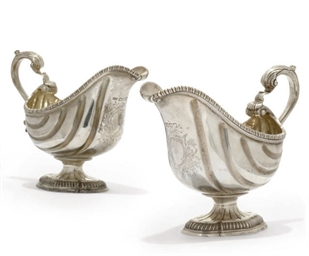 A PAIR OF SILVER REPRODUCTIONS